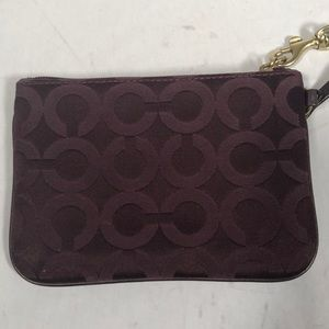 Coach Wristlet. Burgundy and gold